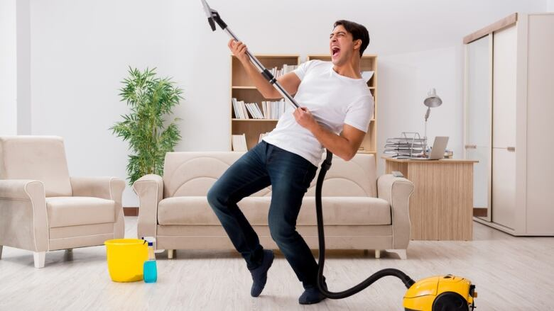 This image has an empty alt attribute; its file name is 519407452-man-happy-to-be-vacuuming.jpg